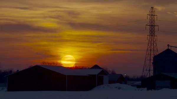 Sun setting on old farm in the winter Royalty-free stock video