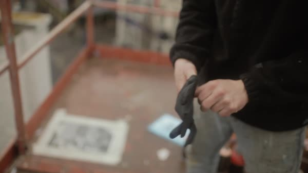 Close-up shot of a man putting on gloves Royalty-free stock video