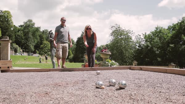 Full shot of middle aged couple playing petanque Royalty-free stock video