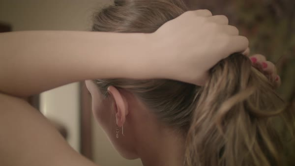 Close-up shot of woman making ponytail Royalty-free stock video