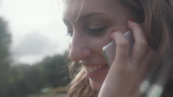 Close-up shot of woman using phone outside Royalty-free stock video
