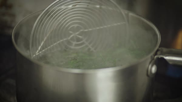 Hand-held shot of sea asparagus being blanched Royalty-free stock video