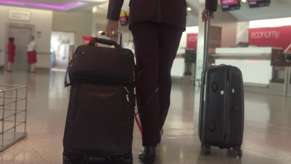 Slow motion shot of a man pulling his suitcases Royalty-free stock video