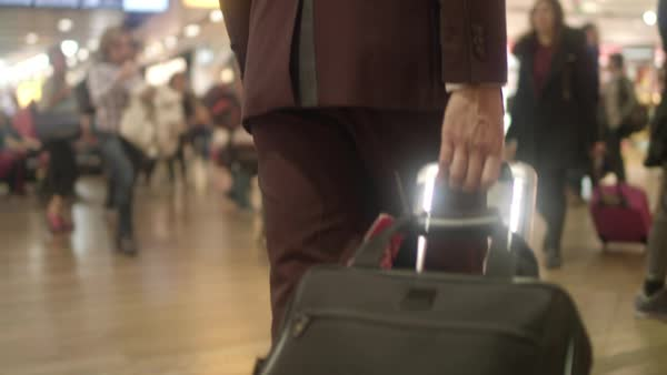 Hand-held shot of a man pulling his suitcase Royalty-free stock video