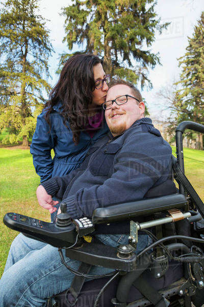 Disabled husband with his wife in a park in autumn; Edmonton, Alberta, Canada Royalty-free stock photo
