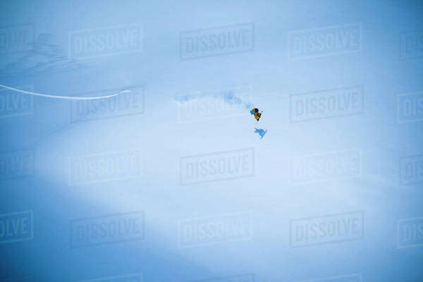 Extreme snowboarding on a snow covered slope; Haines, Alaska, United States of America Royalty-free stock photo