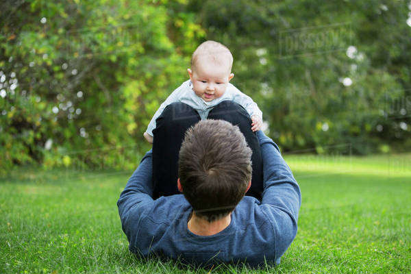 Father spending quality time with his infant daughter; Edmonton, Alberta, Canada Royalty-free stock photo