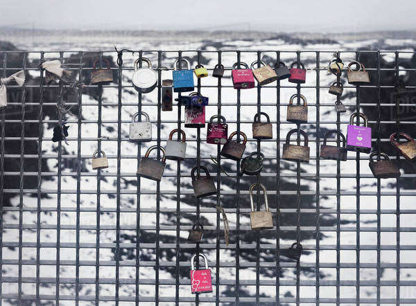 Locks placed on a chain link fence on Leif the Lucky Bridge; Reykjanes Peninsula, Iceland Royalty-free stock photo