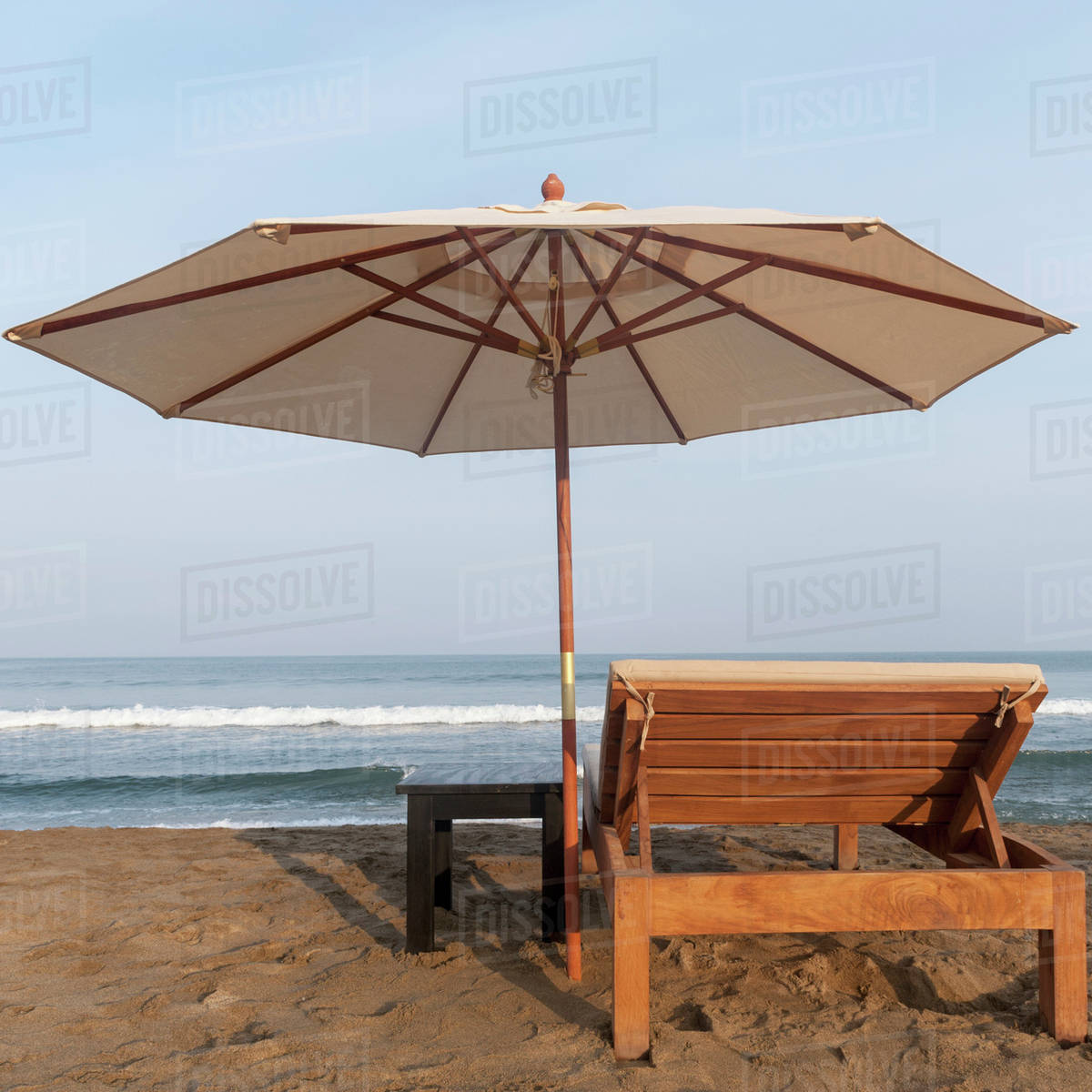 A Lounge Chair And Umbrella On The Beach At Water S Edge Sayulita Mexico