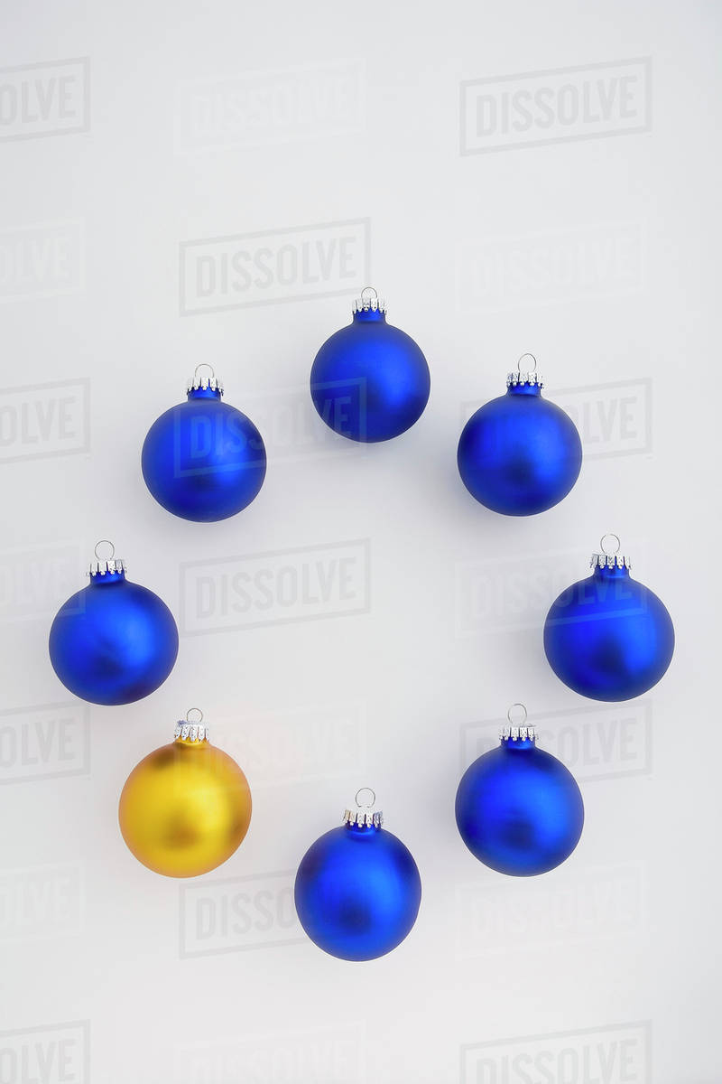 blue christmas tree balls in circle with one gold ball at top studio portrait - Blue Christmas Tree Ornaments