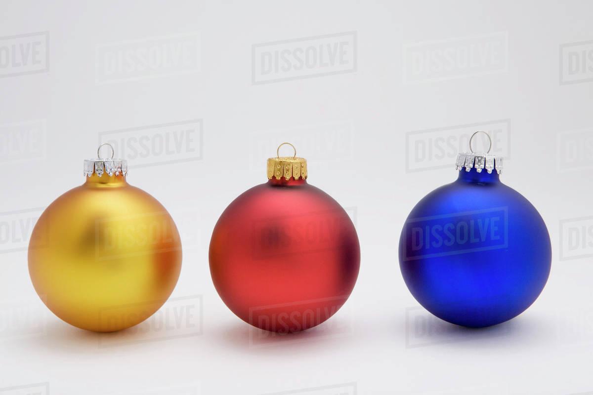 Christmas Tree White Background.Three Christmas Tree Bulb Ornaments On White Background Studio Portrait Stock Photo