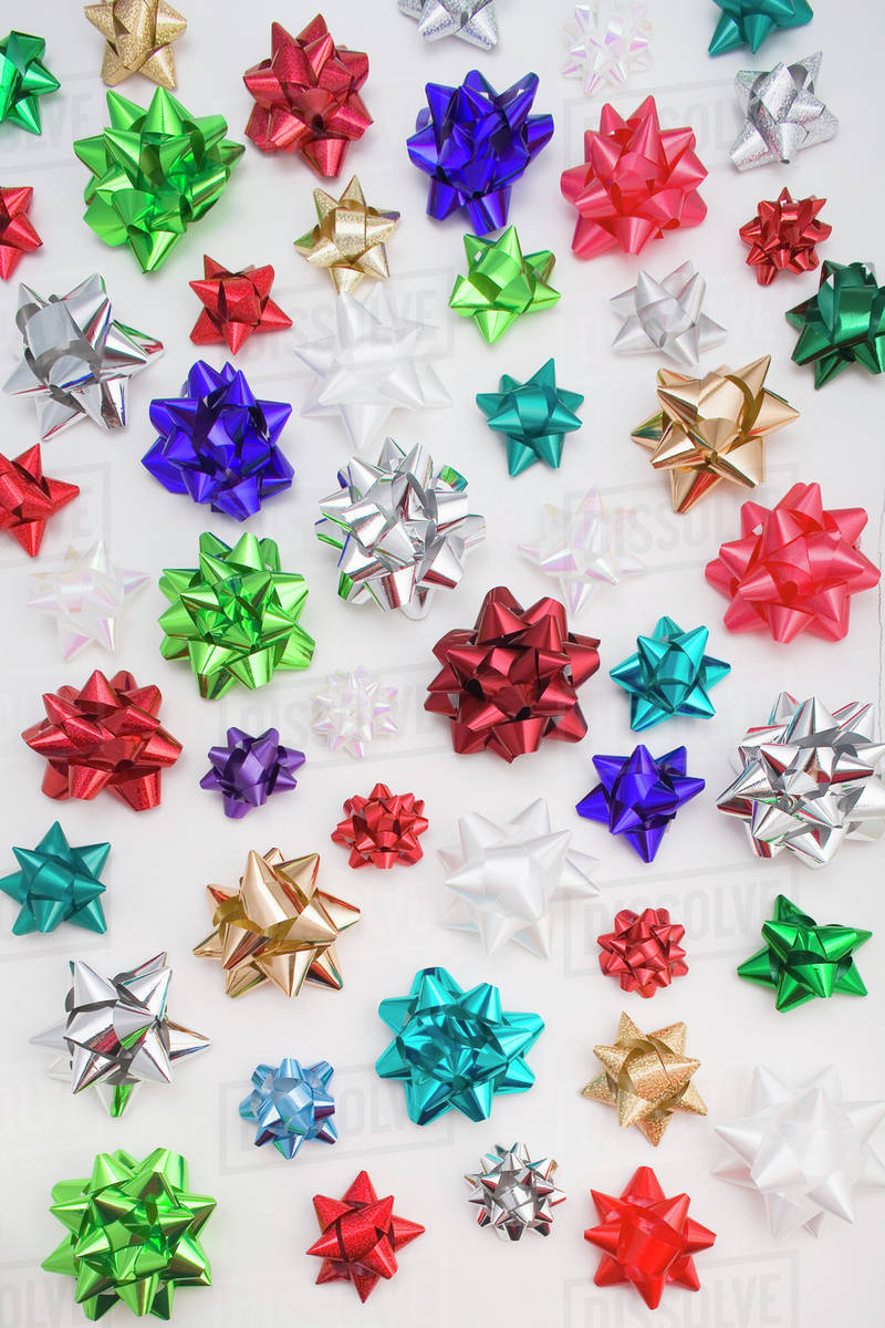 Multiple Colorful Christmas Gift Bows On White Background Studio Portrait  sc 1 st  Dissolve & Multiple Colorful Christmas Gift Bows On White Background Studio ...