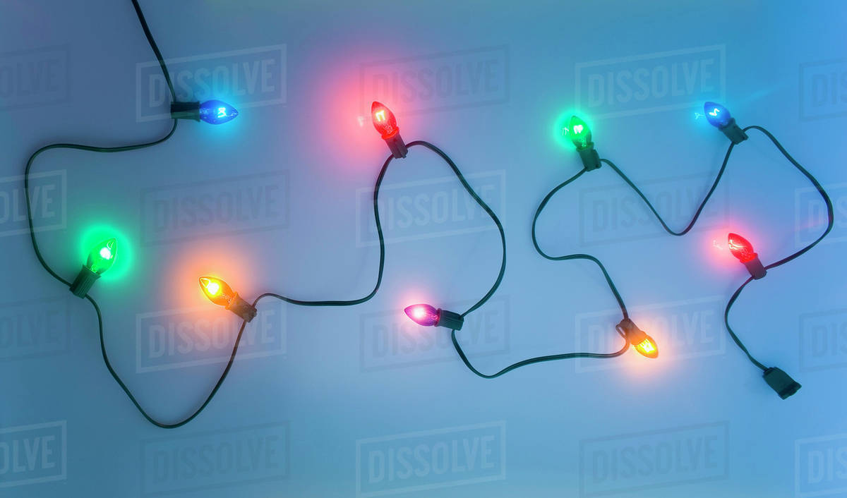 One Black Strand Of Multi-Colored Christmas Tree Lights Waving ...