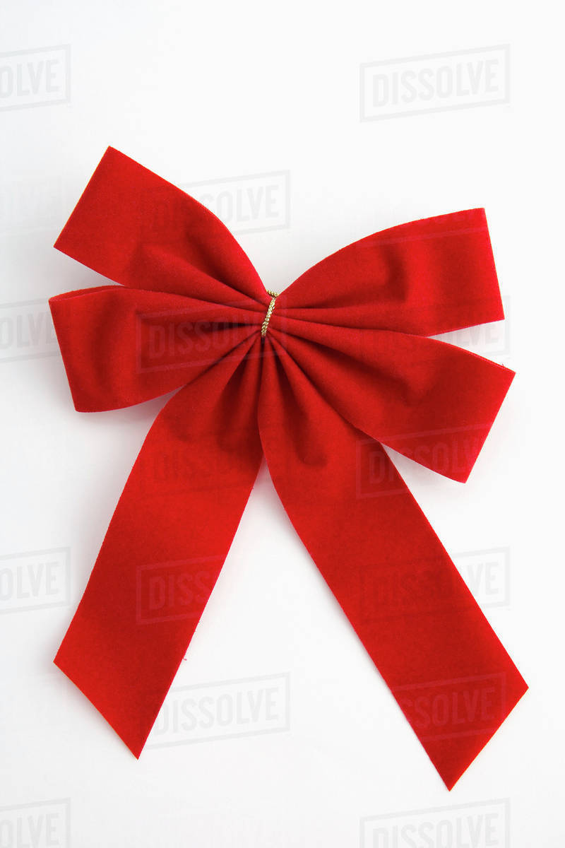 one red traditional christmas bow on white background studio portrait