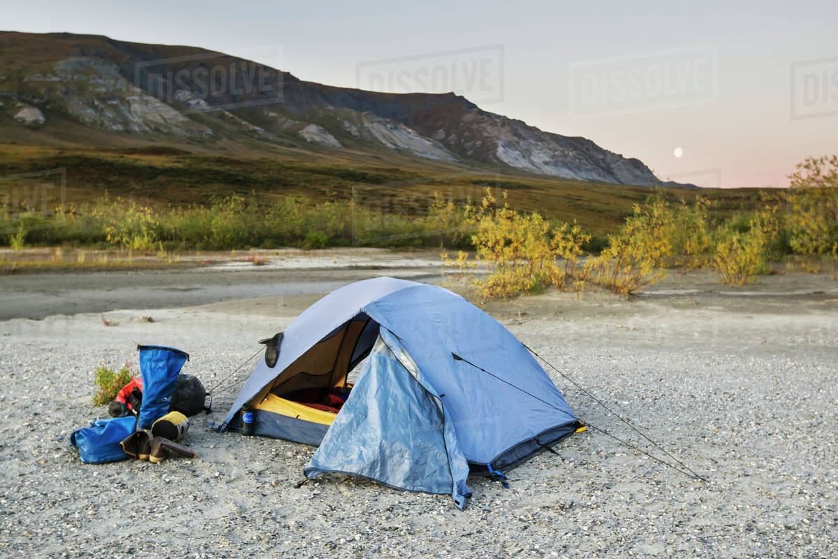 A tent set up with a view of the brooks range gates of the arctic national park northwestern alaska;Alaska united states of america Royalty-free stock photo
