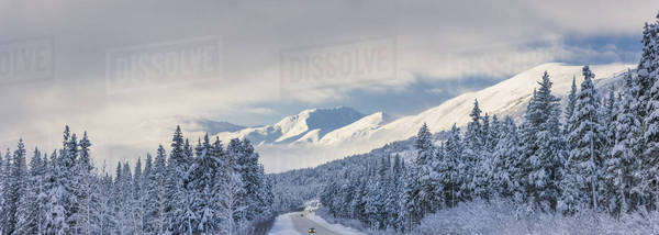Clouds Clearing Over Seward Highway From The Kenai Mountains Above Turnagain Pass After A Winter Snow Storm, Fresh Snow In The Trees, Early Morning Sun, Turnagain Pass, Chugach National Forest, Southcentral Alaska, Usa. Royalty-free stock photo