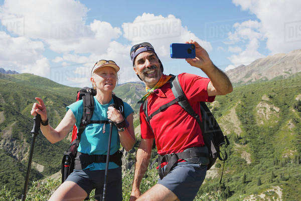 A couple takes a self portrait with a cell phone camera in the mountains; Haines Junction, Yukon, Canada Royalty-free stock photo