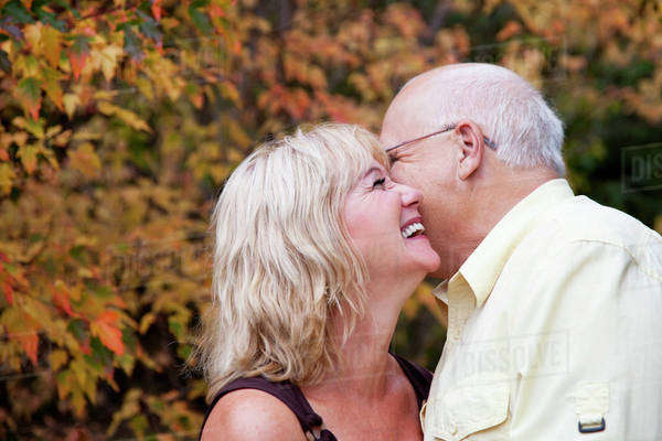 Mature married couple spending time together in a park in autumn;Edmonton alberta canada Royalty-free stock photo