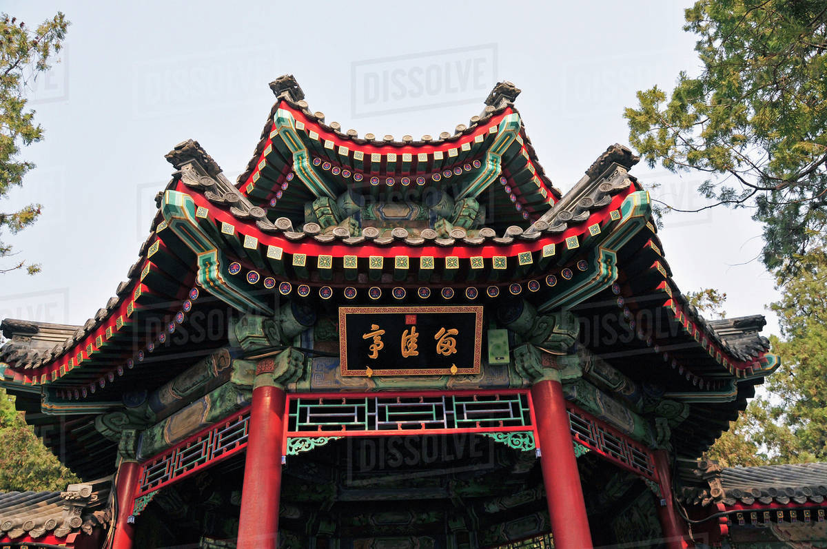 a building with traditional chinese architecture against a blue sky