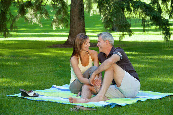 Married Couple Together In A Park; Edmonton, Alberta, Canada Royalty-free stock photo