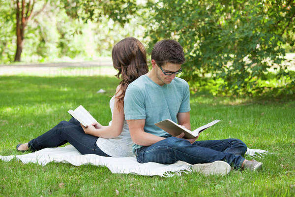 Newlywed Couple Reading Together In A Park; Edmonton, Alberta, Canada Royalty-free stock photo