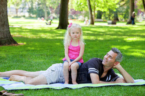 Father And Young Daughter Spending Quality Time Together In A Park; Edmonton, Alberta, Canada Royalty-free stock photo