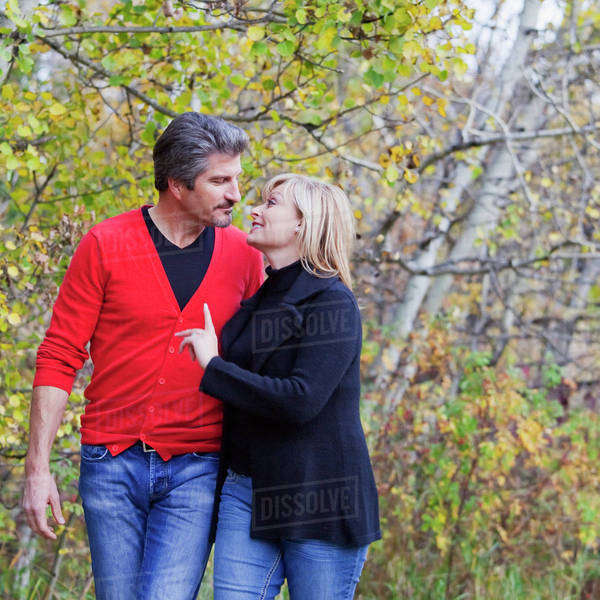 Husband And Wife Walking In A Park In Autumn; St. Albert, Alberta, Canada Royalty-free stock photo