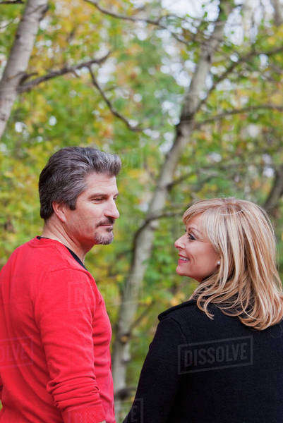 Husband And Wife Together In A Park In Autumn; St. Albert, Alberta, Canada Royalty-free stock photo
