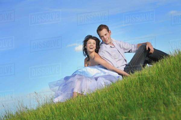 Edmonton, Alberta, Canada; A Couple Sitting On The Grass Together Royalty-free stock photo