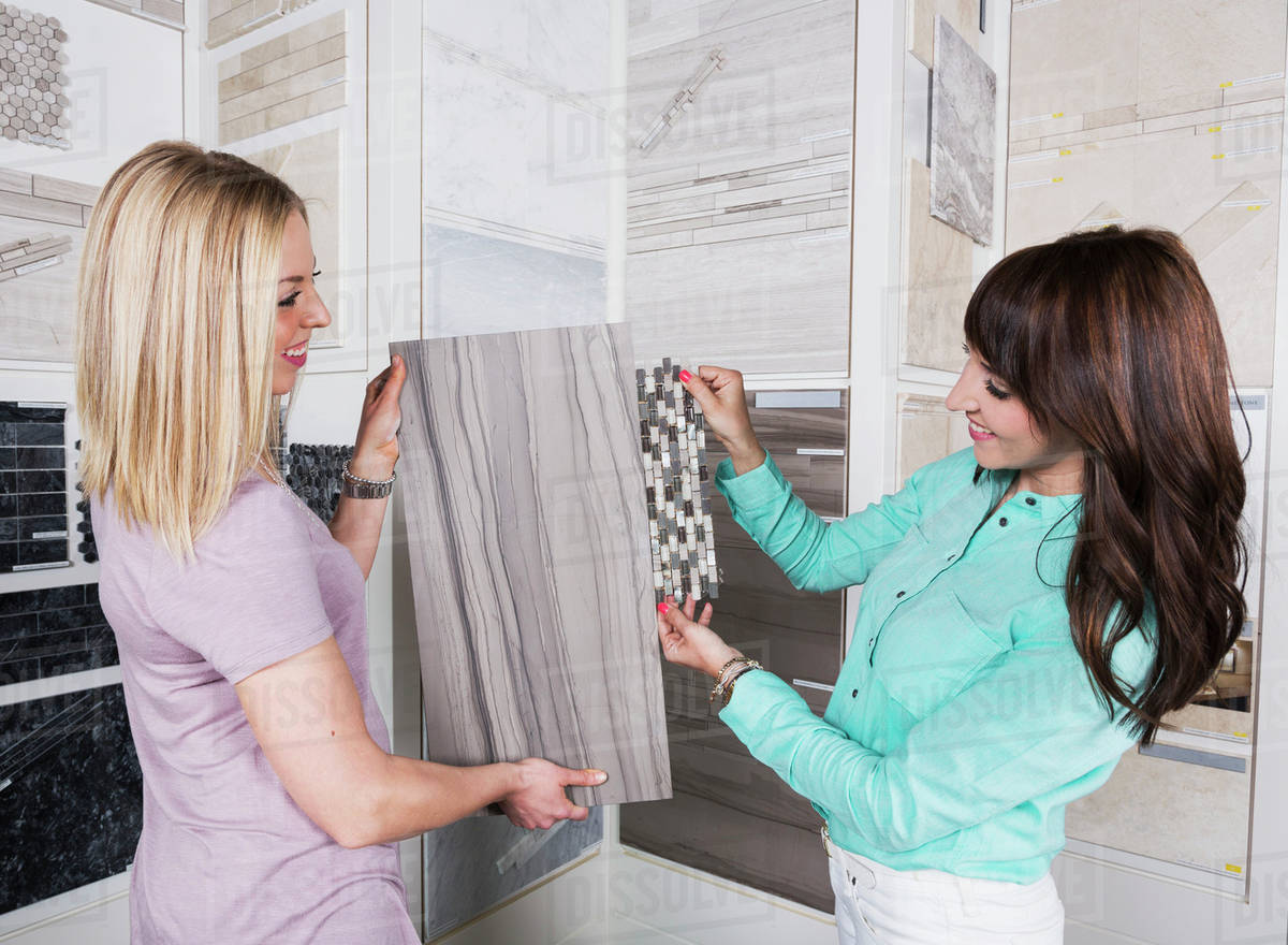 Design Consultant And Interior Designer Selecting Tiles In Showroom Of Tile  Store; Edmonton, Alberta, Canada