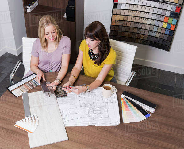 Design Consultant And Interior Designer Selecting Paint And Tile Samples In  A Tile Store; Edmonton
