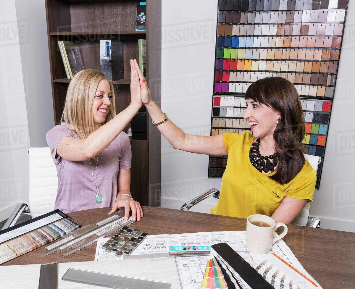 Charming Interior Designer And Design Consultant Meet To Select Paint And Tile  Samples; Edmonton, Alberta, Canada