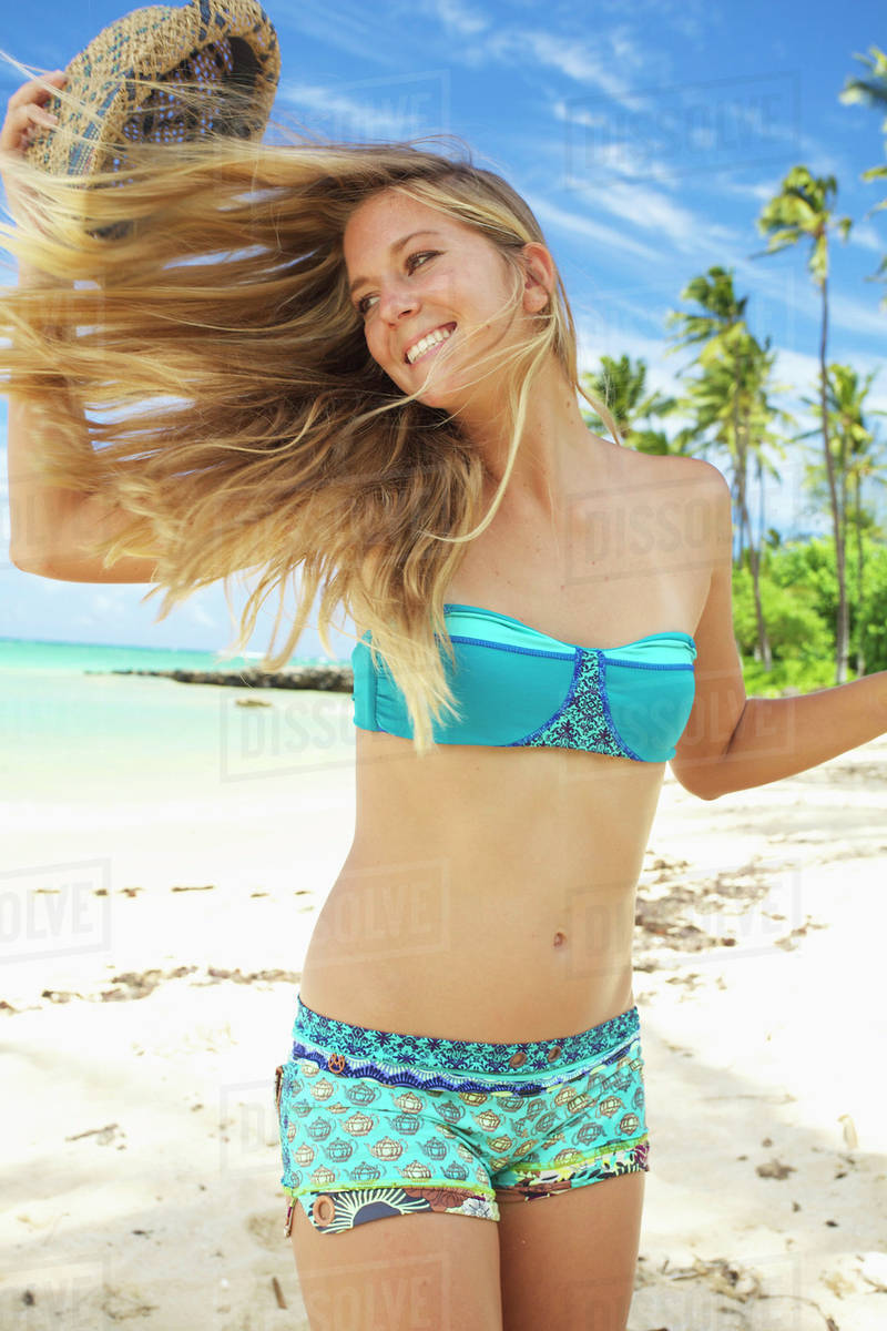 afc055c987777 Young woman in bikini on the beach  Kauai