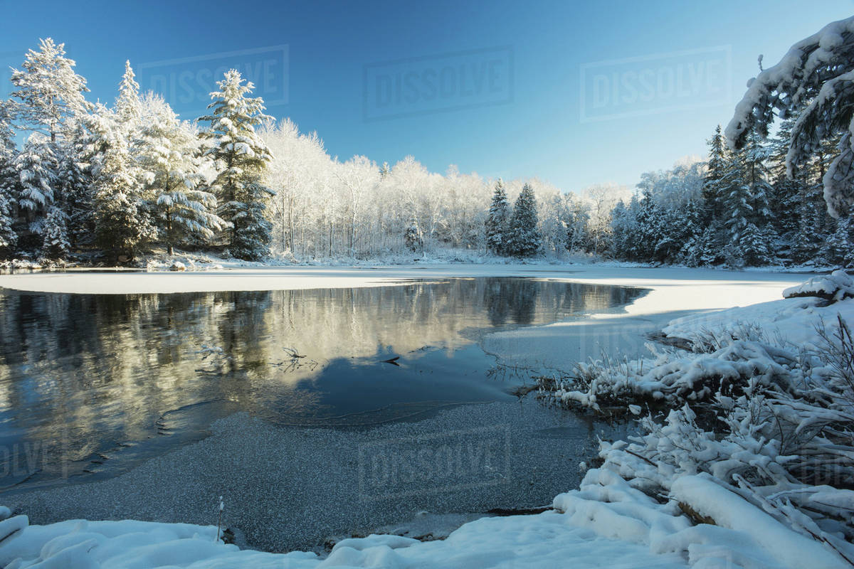 Winter landscape with ice on a lake; Ontario, Canada ...
