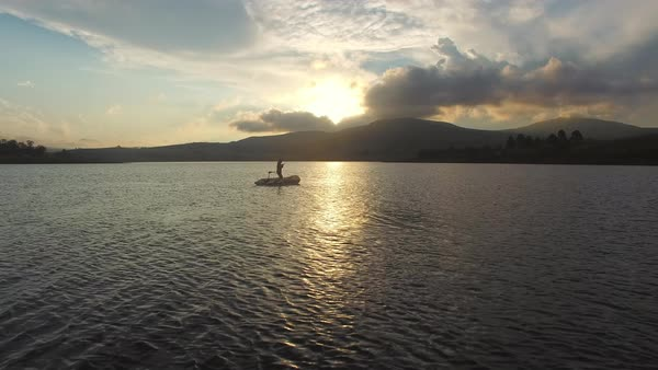 Fisherman fishing from powerboat in lake Royalty-free stock video