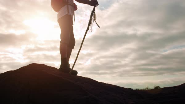 Hiker with walking stick in mountain terrain Royalty-free stock video