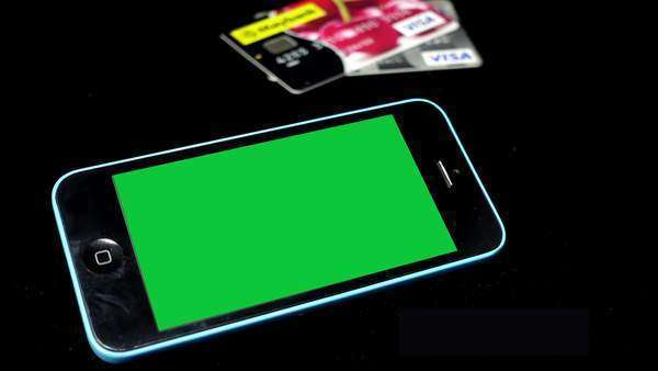 a smartphone with chroma key green screen on black background