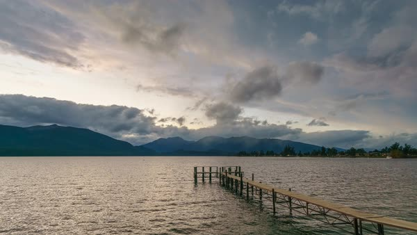 Empty Jetty By The Lake, Te Anau, Southland, New Zealand. Motion Timelapse On A Cloudy But Still Vivid Sky. Pan Left Royalty-free stock video