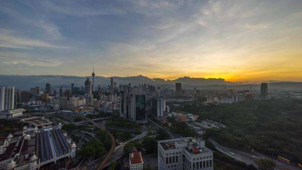 Timelapse of a beautiful sunrise of Kuala Lumpur city view from rooftop of a building Royalty-free stock video