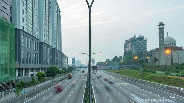 Footage of traffic timelapse at Kuala Lumpur during sunrise. Pan Right to Left. Royalty-free stock video