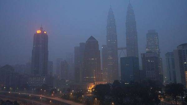 Kuala Lumpur city in the morning sunrise during severe haze. Pan left. Royalty-free stock video
