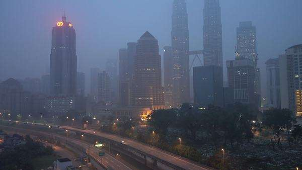 Kuala Lumpur city in the morning sunrise during severe haze. Tilt up. Royalty-free stock video