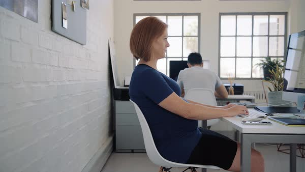 Heavily pregnant business woman manager team leader entrepreneur working in stylish creative office Royalty-free stock video