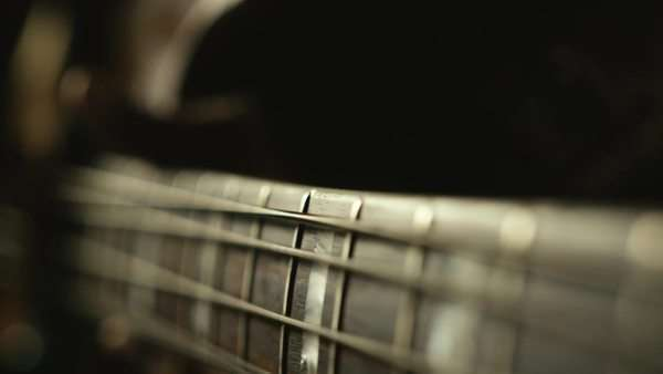 Macro shot of bass guitar strings vibrating in slow motion Royalty-free stock video