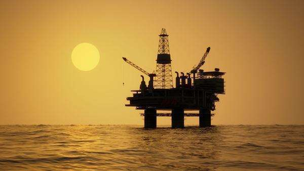 Silhouette of an oil rig drilling platform at sunset Royalty-free stock video