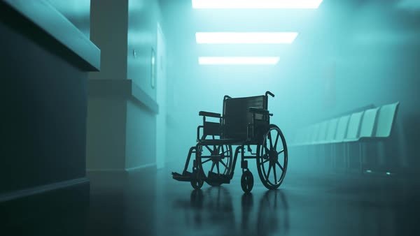 Standard manual wheelchair in empty, foggy hospital corridor Royalty-free stock video