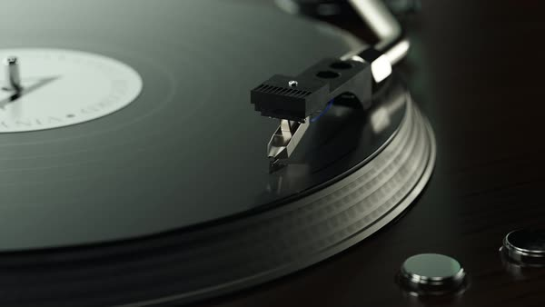 Camera zoom out showing record player with spinning vinyl on it. Royalty-free stock video