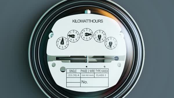 Typical residential analog electric meter with transparent plactic case showing household consumption in kilowatt hours. Electric power usage. Royalty-free stock video