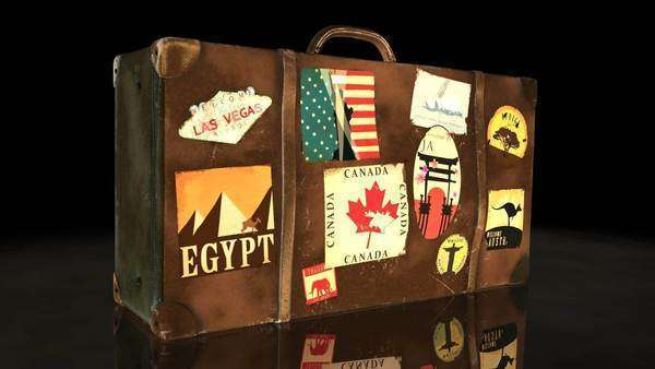 Old Brown Suitcase With World's Famous Travel Destination Labels Royalty-free stock video