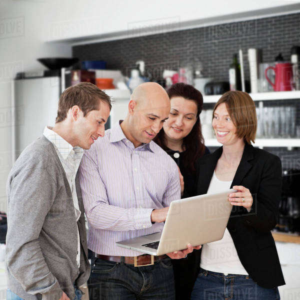 Business people looking at presentation in laptop Royalty-free stock photo